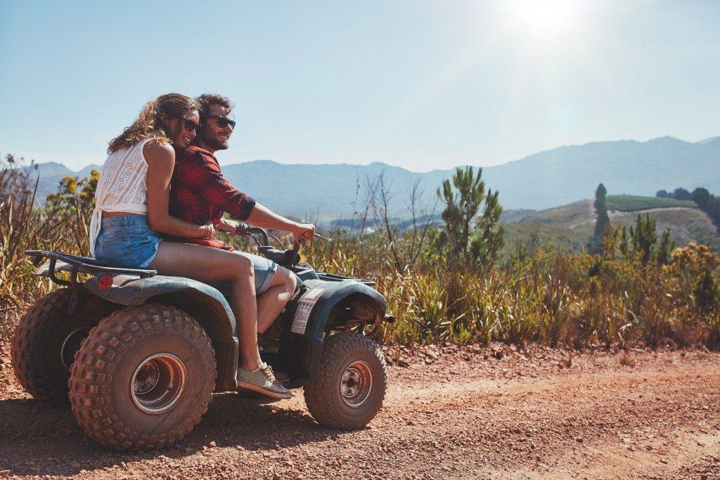 Couple riding an ATV