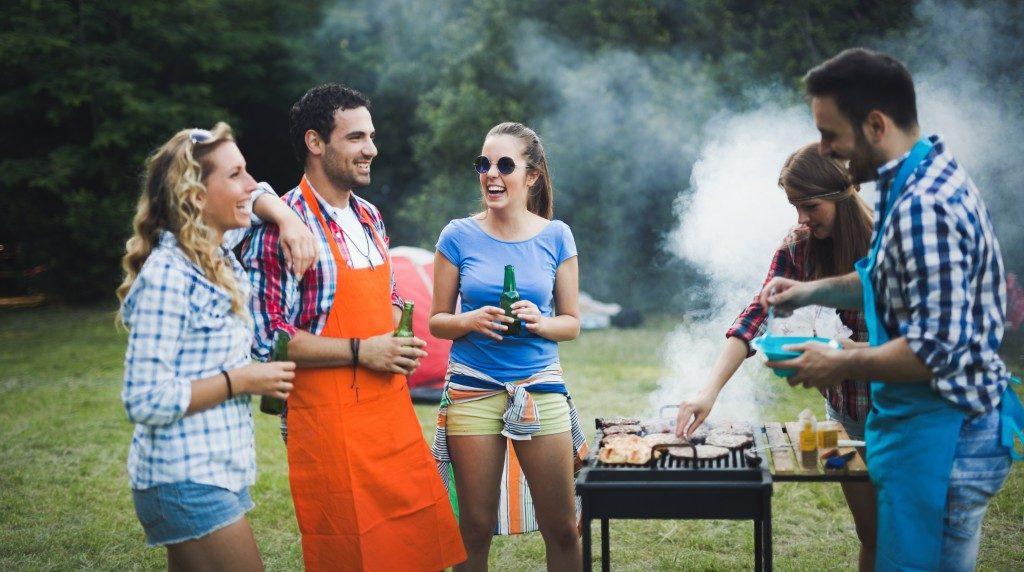Friends having fun grilling meat