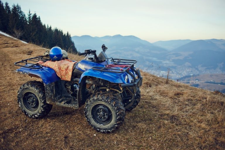 Blue ATV on the mountains