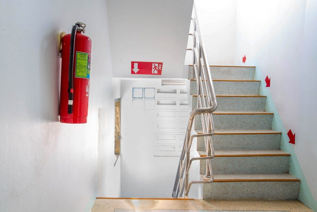 Fire extinguisher in building stairway