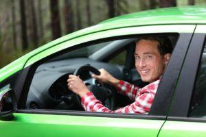 man driving green car